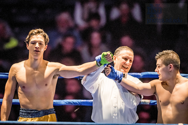 "March 3, 2017; Greg Arts (gold trunks) and Garrett ""FedEx"" Schmelling (blue trunks) stand for the announcement of the winner in their 159lb. division bout. Arts won in a split decision. (Photo by Matt Cashore/University of Notre Dame)"