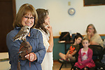 NAUGATUCK, CT, 29 September, 2017 - 092917LW02 - Chris Wrobel, left, holds Sprite, a northern saw-whet owl while Mary-Beth Kaeser speaks about the rescued creature to a group of pre-schoolers at the Whittemore Library in Naugatuck Friday morning. Spite is an educational raptor from Horizon Wings, a wildlife rehabillitation center based in Ashford. <br /> Laraine Weschler Republican-American