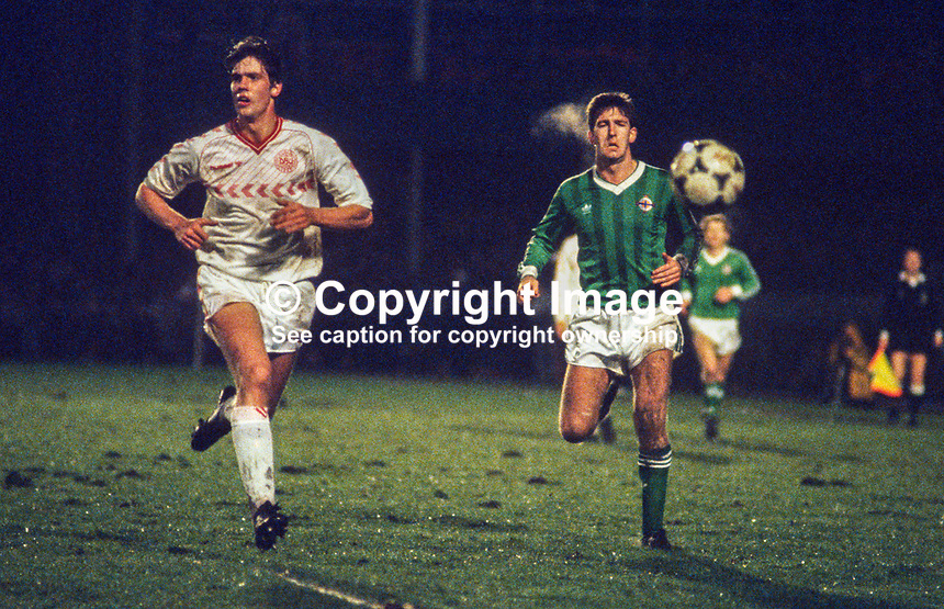 Norman Whiteside, footballer, Manchester United FC & N Ireland, in action against England on 8 March 1986. 19860308NW2.<br /> <br /> Copyright Image from Victor Patterson, 54 Dorchester Park, <br /> Belfast, UK, BT9 6RJ<br /> <br /> t1: +44 28 9066 1296 (from Rep of Ireland 048 9066 1296)<br /> t2: +44 28 9002 2446 (from Rep of Ireland 048 9002 2446)<br /> m: +44 7802 353836<br /> <br /> e1: victorpatterson@me.com<br /> e2: victorpatterson@gmail.com<br /> <br /> www.victorpatterson.com<br /> <br /> Please see my Terms and Conditions of Use at www.victorpatterson.com. It is IMPORTANT that you familiarise yourself with them.<br /> <br /> Images used on the Internet must be visibly watermarked i.e. © Victor Patterson within the body of the image and copyright metadata must not be deleted. Images used on the Internet have a size restriction of 4kbs and will be chargeable at current NUJ rates unless advised otherwise.<br /> <br /> This image is only available for the use of the download recipient i.e. television station, newspaper, magazine, book publisher, etc, and must not be passed on to any third party. It is also downloaded on condition that each and every usage is notified within 7 days to victorpatterson@me.com<br /> <br /> The right of Victor Patterson to be identified as the author is asserted in accordance with The Copyright Designs And Patents Act (1988).