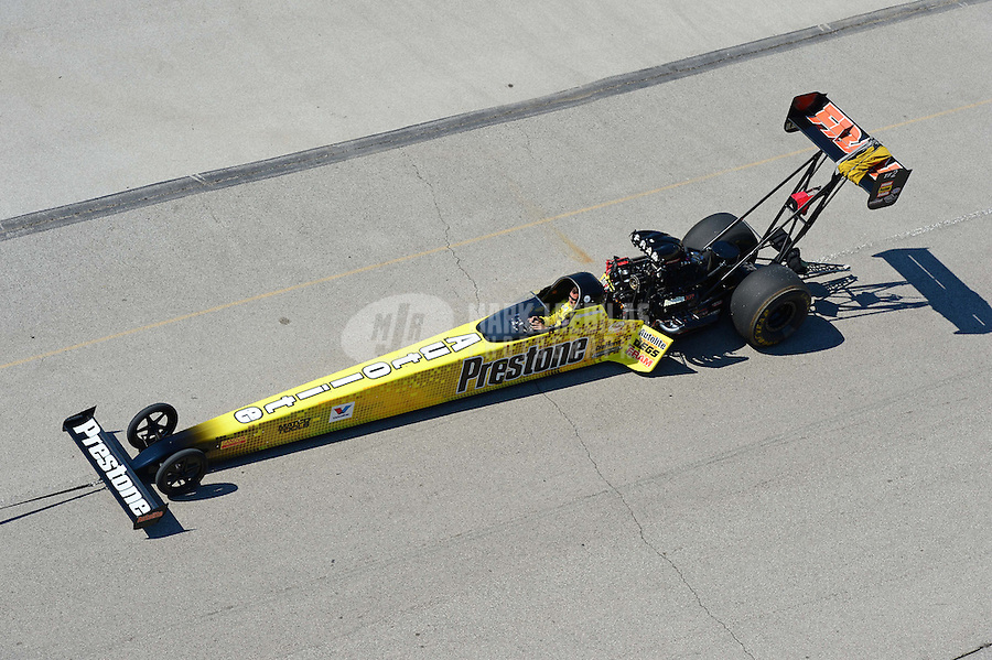Sept. 29, 2012; Madison, IL, USA: NHRA top fuel dragster driver Spencer Massey being towed back to the pits during qualifying for the Midwest Nationals at Gateway Motorsports Park. Mandatory Credit: Mark J. Rebilas-