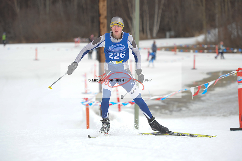 Eagle River's Bradan Tobin crests a hill enroute to a 52 nd-place finish in Thursday's freestlyle event during the state championships at Kincaid Park.  Photo for the Star by Michael Dinneen