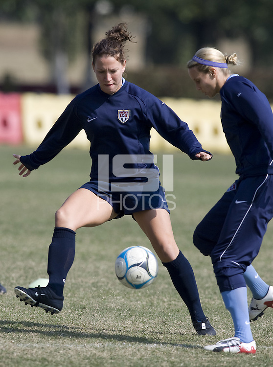 USA forward Lauren Cheney tries to cut off the pass of midfielder  Leslie Osborne during practice in preparation for the Four Nations Tournament in Guangzhou, China on January 15, 2008