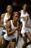 NWA Democrat-Gazette/ANDY SHUPE<br /> Arkansas' Kiara Parker receives the baton Saturday, May 11, 2019, from Paris Peoples as they compete in the 4x400-meters during the SEC Outdoor Track and Field Championships at John McDonnell Field in Fayetteville. Visit nwadg.com/photos to see more photographs from the meet.