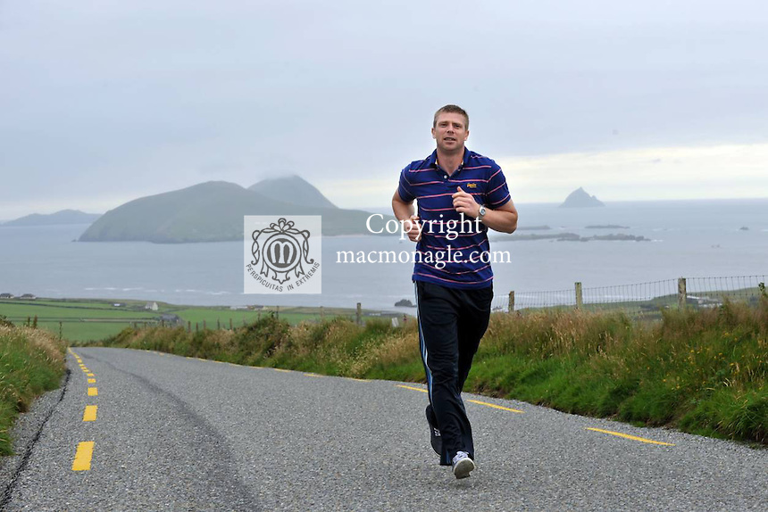GAA History to be made: Kerry footballer Tomas O'Se pictured overlooking the Blasket Islands outside Dingle in County Kerry this week ahead of becoming the most 'capped' GAA footballer in the country surpassing his brother Darragh with 82 championships appearances when he lines out against Clare on Saturday. Tomas first played in the Munster semi-final against Cork in Killarney in July 1998. He has worn the no5 jersey at half back on most occassions, a position made famous also by his uncle Paidi O'Se. He holds 5 All-Ireland medals and 8 Munster championships..Picture by Don MacMonagle