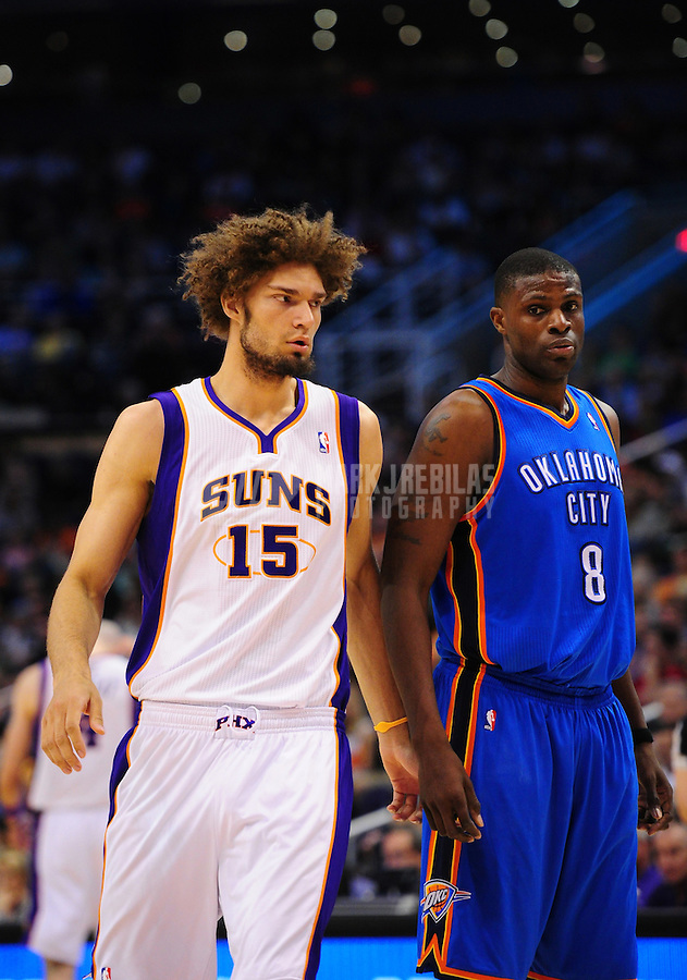 Mar. 30, 2011; Phoenix, AZ, USA; Phoenix Suns center Robin Lopez (left) against Oklahoma City Thunder center Nazr Mohammed at the US Airways Center. Mandatory Credit: Mark J. Rebilas-.