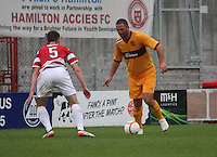 Michael Higdon takes on Michael Devlin in the Hamilton Academical v Motherwell friendly match played at New Douglas Park, Hamilton on 24.7.12..
