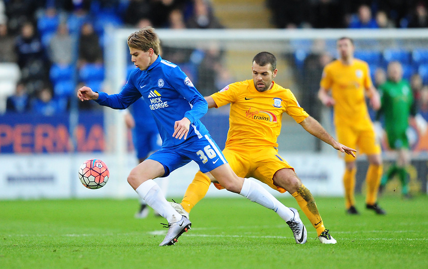Peterborough United's Martin Samuelsen shields the ball from Preston North End's John Welsh<br /> <br /> Photographer Chris Vaughan/CameraSport<br /> <br /> Football - The FA Cup Third Round - Peterborough United v Preston North End - Saturday 9th January 2016 - ABAX Stadium - Peterborough <br /> <br /> &copy; CameraSport - 43 Linden Ave. Countesthorpe. Leicester. England. LE8 5PG - Tel: +44 (0) 116 277 4147 - admin@camerasport.com - www.camerasport.com