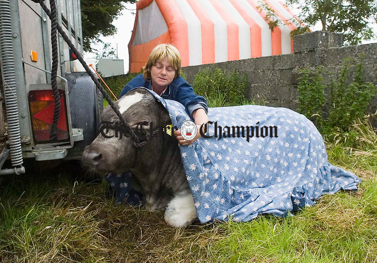 Vera Killeen of Mullagh keeps her charge warm and dry for showing at Corofin Show.Photograph by John Kelly