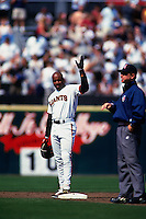 SAN FRANCISCO, CA - Barry Bonds of the San Francisco Giants waves to the fans while standing on second base after getting his 2,000th career hit during a game at Candlestick Park in San Francisco, California on September 11, 1999. Photo by Brad Mangin
