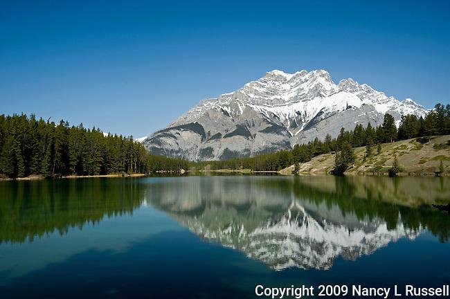 Cascade mountain reflecting onto Johnson Lake near Banff, Alberta, Canada