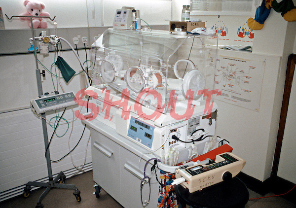 Premature infant in a high dependency intensive care incubator in a special care baby unit. This image may only be used to portray the subject in a positive manner..©shoutpictures.com..john@shoutpictures.com