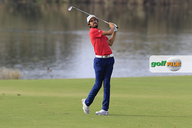Joao Ramos (POR) plays his 2nd shot on the 14th hole during Thursday's Round 1 of the 2016 Portugal Masters held at the Oceanico Victoria Golf Course, Vilamoura, Algarve, Portugal. 19th October 2016.<br /> Picture: Eoin Clarke | Golffile<br /> <br /> <br /> All photos usage must carry mandatory copyright credit (&copy; Golffile | Eoin Clarke)