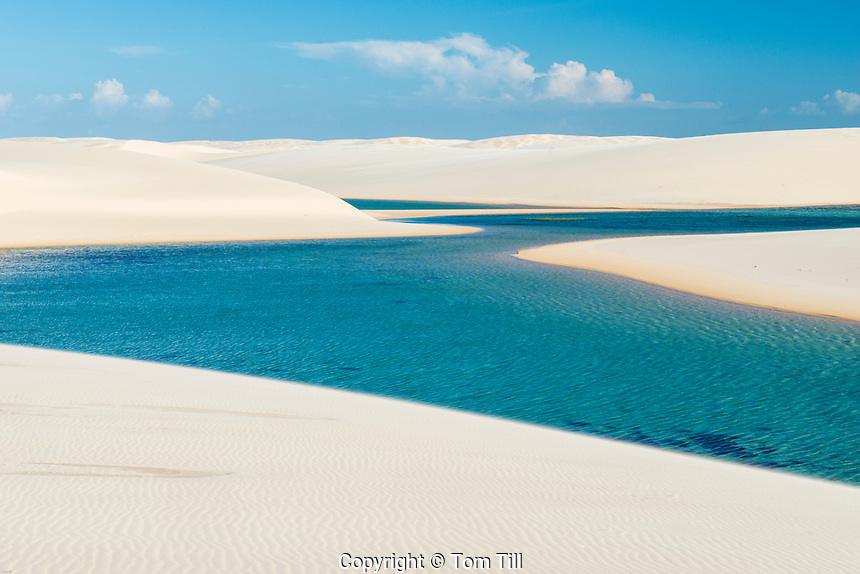 Rainwater  ponds trapped in white dunes, Lencois Maranhenses National Park, Brazil, Atlantic Ocean