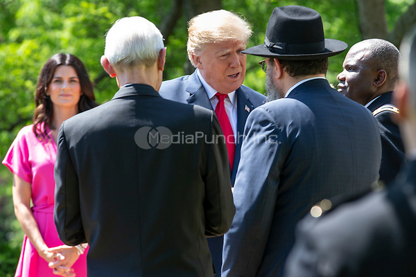 United States President Donald J. Trump greets religious leaders prior to speaking at a National Day of Prayer event in the Rose Garden at the White House in Washington, DC on May 3, 2018. Credit: Alex Edelman / CNP /MediaPunch