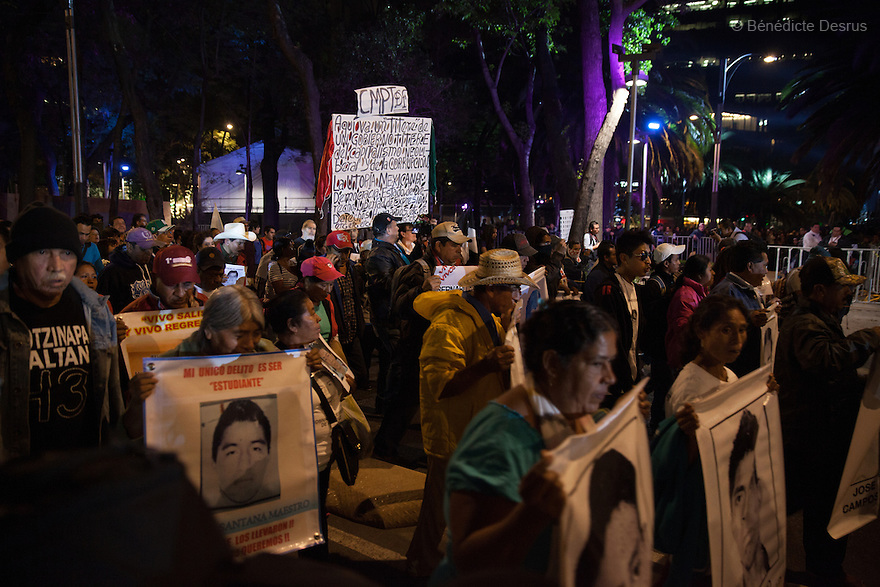 Demonstrators, along with the Parents and relatives of the 43 missing students of the Ayotzinapa Teacher Training College Raul Isidro Burgos, during a New Year's Eve march towards Los Pinos presidential residence in Mexico City, Mexico on December 31, 2014. The relatives of the 43 missing students do not believe the official line that the young men are all dead. The 43students went missingon Sept. 26 after confrontations in which police gunfirekilled six peopleandwoundedat least25inIguala, in Guerrero state. Alexander Mora Venancio, one of the 43 Ayotzinapa's missingstudents, has been identified and confirmed dead by authorities.Many are demanding justice and that the search for the 42 missing students continue until there is concrete evidence to the contrary. Mexico – officially - lists more than 20 thousand people as having gone missing since the start of the country's drug war in 2006, and the search for the missing students has turned up other, unrelated mass graves.(Photo by BénédicteDesrus)