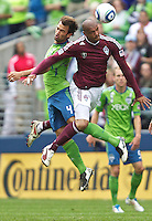 Seattle Sounders FC defender Patrick Ianni battles Colorado Rapids forward Caleb Folan during play at CenturyLink Field in Seattle Saturday July 17, 2011. The Sounders won the game 4-3.