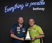 20.05.2015. London,  England. Betway Premier League Darts, Play-Offs Media Day. [L-R] Reigning Betway Premier League Champion Raymond van Barneveld and world number one,  Michael van Gerwen with the Betway Premier League Trophy.