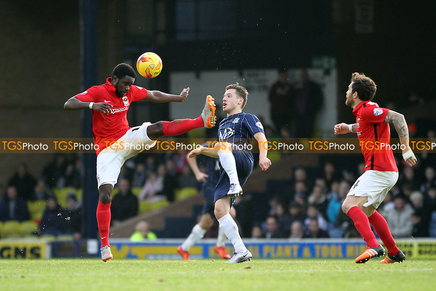 Gaël Bigirimana of Coventry City and Jack Payne of Southend United both go for the ball during Southend United vs Coventry City, Sky Bet League 1 Football at Roots Hall, Southend, England on 23/01/2016