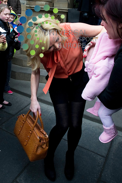 Britains Got Talent judges leaving the Balmoral Hotel and head for the Festival Theatre, Edinburgh, Scotalnd, 11th February, 2012 Pictured Amanda Holden takes a shine to a new born baby in the crowd..Picture:Scott Taylor Universal News And Sport (Europe) .All pictures must be credited to www.universalnewsandsport.com. (Office)0844 884 51 22.