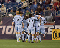Colorado Rapids midfielder Mehdi Ballouchy (8) celebrates his goal with teammates. The Colorado Rapids defeated the New England Revolution, 2-1, at Gillette Stadium on April 24, 2010.