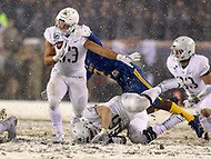 Philadelphia, PA - December 9, 2017:    Army Black Knights running back Darnell Woolfolk (33) avoids a tackle during the 118th game between Army vs Navy at Lincoln Financial Field in Philadelphia, PA. (Photo by Elliott Brown/Media Images International)