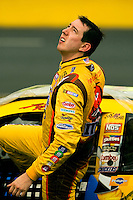 NASCAR driver Kyle Busch, driver of the No. 18 M&M's/Interstate Batteries Toyota Camry for Joe Gibbs Racing, waits out the rain during the 2009 Coca-Cola Classic 600 race at the Lowe's Motor Speedway, in Concord, NC. NASCAR Driver David Reutimann won his first Cup race during the rain-shortened event, held May 25, 2009. NASCAR's longest scheduled race went only 227 laps, or 340.5 miles, before officials ended it because of rain. The 2009 race was the 50th running of the Coca-Cola 600. Ryan Newman and Robby Gordon finished second and third respectively.