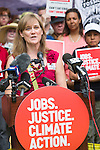 Jennifer Henry speaks at the Press Conference before the Jobs, Justice and Climate march in Toronto. On July 5th more than 10,000 people gathered in Toronto, the traditional territories of the Missisauga peoples, for the March for Jobs, Justice and the Climate. The march told the story of a new economy that works for people and the planet. People marched for an economy that starts with justice, creates good work, clean jobs and healthy communities. The people recognize that we have solutions and we know who is responsible for causing the climate crisis. (Photo: Robert van Waarden)