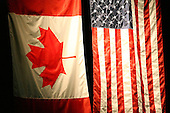 February 24th 2008:  The Canadian and United States flag during the national anthem at Blue Cross Arena at the War Memorial in Rochester, NY before a Houston Aeros at Rochester Amerks game.  The Aeros defeated the Amerks 4-0.   Photo copyright Mike Janes Photography 2008