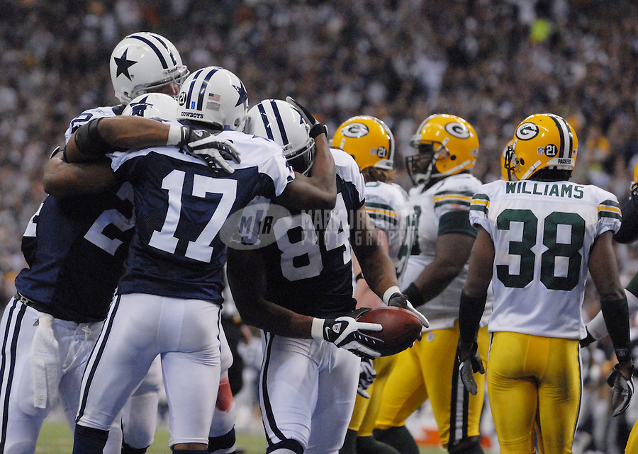 Nov. 29, 2007; Irving, TX, USA; Dallas Cowboys wide receiver Patrick Crayton (84) is congratulated by teammates after scoring a fourth quarter touchdown against the Green Bay Packers at Texas Stadium. Dallas defeated Green Bay 37-27. Mandatory Credit: Mark J. Rebilas-US PRESSWIRE