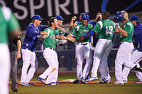 Tulsa Drillers pinch hitter Chase De Jong (34) is mobbed by teammates including Brandon Trinkwon (8), Ralson Cash, Alex Verdugo, Tyler Ogle, Yadir Drake (12) after a walk off bunt due to an error during a game against the Arkansas Travelers on April 28, 2016 at ONEOK Field in Tulsa, Oklahoma.  Tulsa defeated Arkansas 5-4.  (Mike Janes/Four Seam Images)