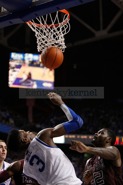 Freshman forward Nerlens Noel goes for the rebound during the Men's University of Kentucky basketball game against Texas A&M at Rupp Arena on January 12th, 2013. Photo by Kirsten Holliday | Staff