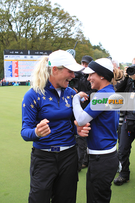 Suzann Pettersen (EUR) and Azahara Munoz (EUR) after they won on the final day of  the Solheim Cup 2011 at Killeen Castle, Co. Meath, Ireland...Photo Golffile/Jenny Matthews.(Photo credit should read Jenny Matthews www.golffile.ie)....This Picture has been sent you under the conditions enclosed by:.Newsfile Ltd..The Studio,.Millmount Abbey,.Drogheda,.Co Meath..Ireland..Tel: +353(0)41-9871240.Fax: +353(0)41-9871260.GSM: +353(0)86-2500958.email: pictures@newsfile.ie.www.newsfile.ie.