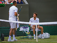 London, England, 5 th. July, 2018, Tennis,  Wimbledon, Men's singles, Robin Haase (NED) looks on to  Nick Kyrgios (AUS) during changeover<br />