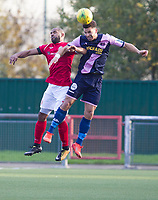 Nathan Green of Dulwich Hamlet wins an aerial dual with Jimmy Shepherd of Harlow Town  during Harlow Town vs Dulwich Hamlet, Buildbase FA Trophy Football at The Harlow Arena on 11th November 2017