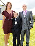 Evan Boardman from St Josephs school who recieved first holy communion at St Josephs Church Mell pictured with parents David and Julie. Photo: Colin Bell/pressphotos.ie