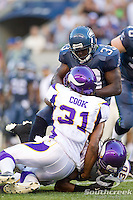 Seattle Seahawks running back Leon Washington (33) is tackled by Minnesota Vikings cornerback Chris Cook (31) and safety Mistral Raymond (30) at CenturyLink Field in Seattle, Washington. The Minnesota Vikings won the game, 20-7.