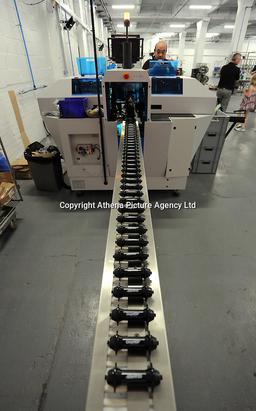 Pictured: A line of wheel parts entering an assembly machine Monday 15 August 2016<br />