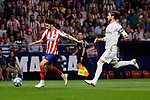 Joao Felix of Atletico de Madrid and Sergio Ramos of Real Madrid during La Liga match between Atletico de Madrid and Real Madrid at Wanda Metropolitano Stadium{ in Madrid, Spain. {iptcmonthname} 28, 2019. (ALTERPHOTOS/A. Perez Meca)