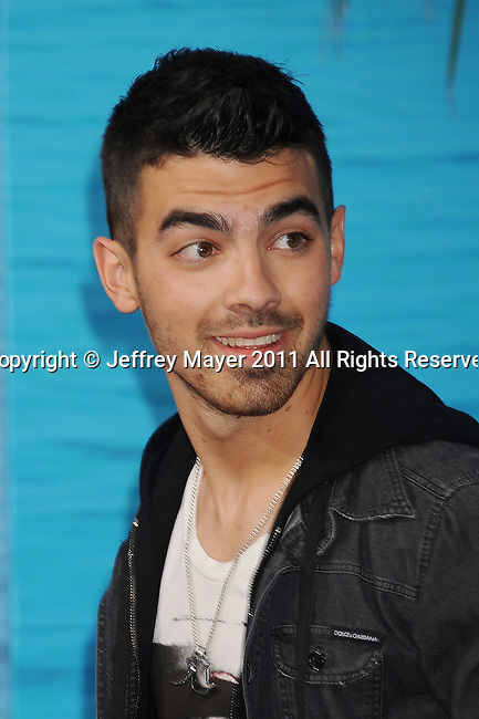 "HOLLYWOOD, CA - MARCH 30: Joe Jonas attends the ""Soul Surfer"" Los Angeles Premiere at ArcLight Cinemas on March 30, 2011 in Hollywood, California."