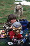 Child wears John Major mask, the Conservative Prime Minister. At Penmaenmawr Quarry area, Stone Circle gathering in Wales. 1990s<br />