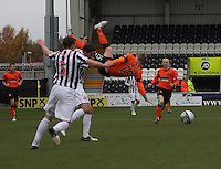 Michael Gardyne falling acrobaticallly over Lee Mair in the St Mirren v Dundee United Clydesdale Bank Scottish Premier League match played at St Mirren Park, Paisley on 27.10.12.