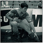 JUNE 1995    -  Sydney, Australia   - At the Sydney Stadium a rugby player from the Rugby League holds his mouthpiece during a break in the action.