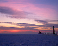 Grand Haven State Park, MI<br /> Grand Haven Lighthouse and Lake Michigan under winter sunset clouds