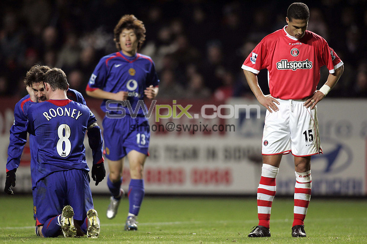 Pix: Rob Matthews/SWpix.com. Soccer. Barclays Premiership. Season 2005/2006. Charlton v Manchester United. 19/11/2005...COPYWRIGHT PICTURE>>SIMON WILKINSON>>01943 608782>>..Ruud Van Nistelrooy is mobbed by Wayne Rooney after scoring his second goal as a dejected Talal El Karkouri looks on.