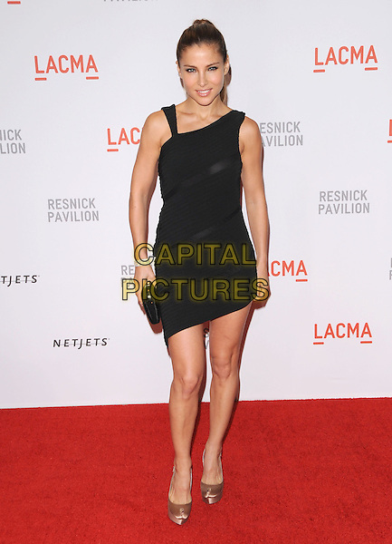 "ELSA PATAKY  .at LACMA's ""The Unmasking"" The Lynda & Stewart Resnick Exhibition Pavilion Opening Gala at The Los Angeles County Museum of Art in Los Angeles, California, USA, September 25th 2010. full length gold shoes black dress  clutch bag platform asymmetric hem  beige blush silk satin peep toe                                                                         .CAP/RKE/DVS.©DVS/RockinExposures/Capital Pictures."