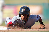 Surprise Saguaros second baseman Leury Garcia #7 dives back to first on a pickoff attempt during an Arizona Fall League game against the Scottsdale Scorpions at Scottsdale Stadium on October 31, 2011 in Scottsdale, Arizona.  Surprise defeated Scottsdale 8-5.  (Mike Janes/Four Seam Images)