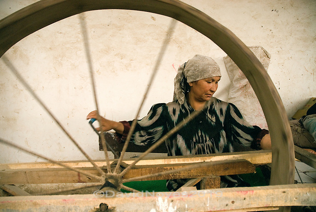At a small workshop in the remote oasis town of Hotan (Khotan) visitors can witness the entire silk-making process, the way it has been done for centuries along China's Silk Road. Uyghur women boil the cocoons, reel the strands, spin the thread, and weave the fabric..