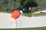 Lee Westwood plays his 2nd shot from a fairway bunker on the 15th hole during Day 2 of the Dubai World Championship, Earth Course, Jumeirah Golf Estates, Dubai, 26th November 2010..(Picture Eoin Clarke/www.golffile.ie)