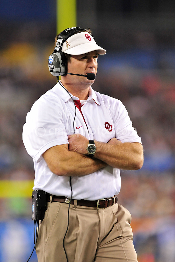 Jan 1, 2011; Glendale, AZ, USA; Oklahoma Sooners head coach Bob Stoops paces on the sidelines in the 4th quarter of the 2011 Fiesta Bowl against the Connecticut Huskies at University of Phoenix Stadium.  The Sooners won the game 48-20.