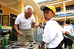 "Vietnam War veteran Mark Oconnor examines a new bicycle he has just given to a boy in the rural highlands district of A Luoi, Vietnam. Oconnor, who served in the war from 1970 to 1971, recently gave away 55 bicycles to ethnic minority students in the district who live too far from school to walk there every day. ""I took too much the first time I was over here, and now I am trying to give back,"" said Oconnor, 63, of Sioux Falls, S.D. ""It probably won't ever be enough, but I want to do what I can."" Oconnor said he plans to return to Vietnam next year and give away at least 200 more bicycles to poor children. ""I'm a pretty healthy guy,"" he said. ""So, I'm going to keep this up until I can't do it anymore."" April 21, 2014."